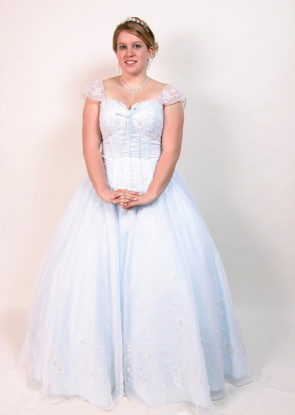 Pretty young girl in pale blue / white prom gown